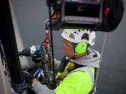 Rope Access worker with ActSafe ACC Power Ascender working on bridge using an Makita.